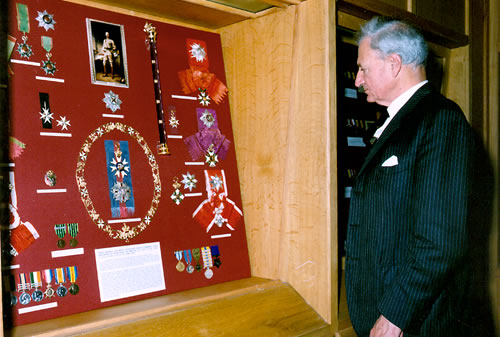 Earl Kitchener of Khartoum examines his great uncle's medals